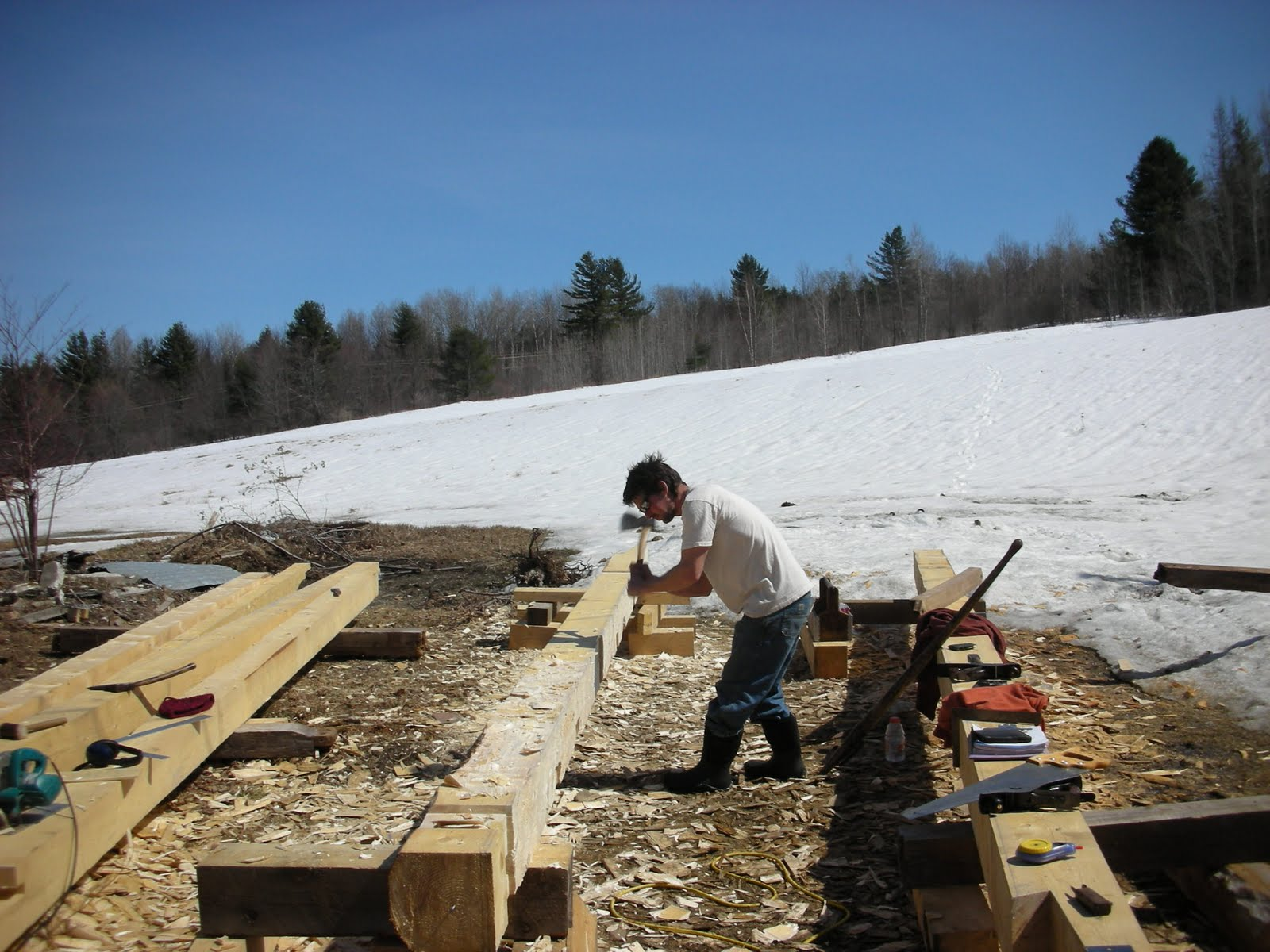 Seth Kelley scores one of the new plate timbers before surfacing with a broad axe.
