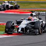 Jenson Button leads Kevin Magnussen for McLaren