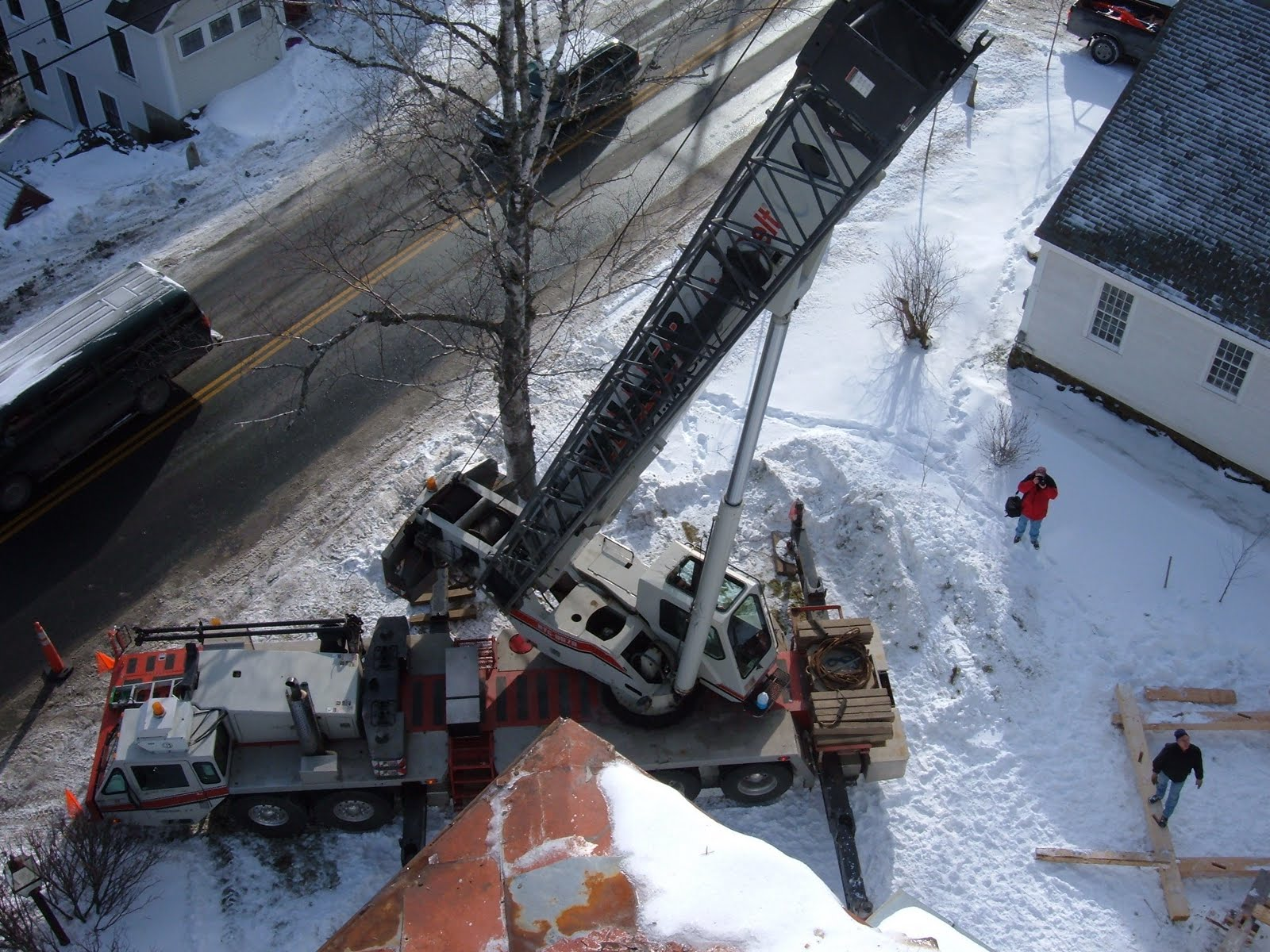 Jan Lewandoski waits below for the roof to be lowered.