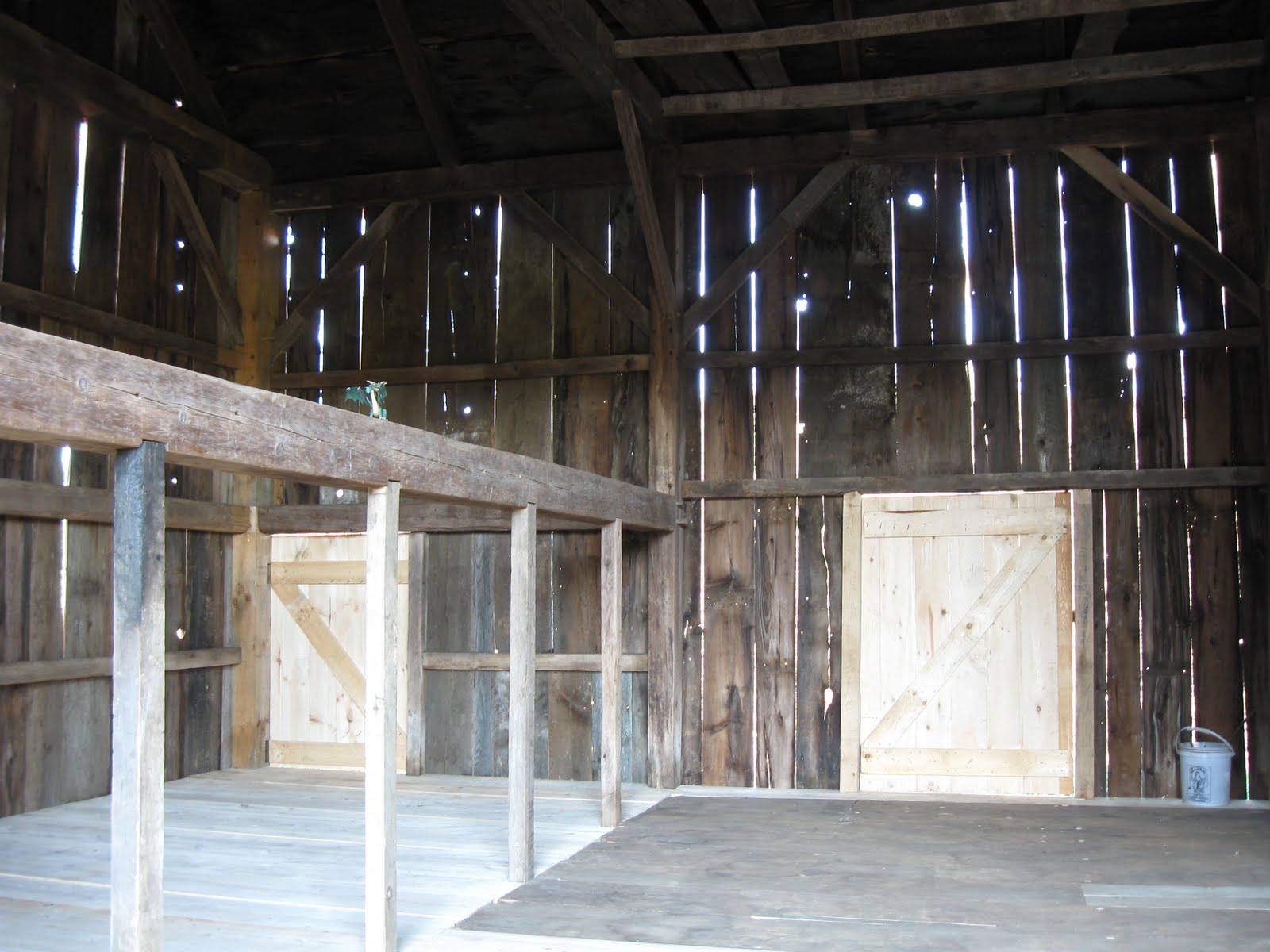 A view of the finished interior with pegged planks in the drive and three inch thick planks clear-spanning in the stanchion bay.