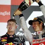 Jenson Button gives Sebastian Vettel a Champagne shower