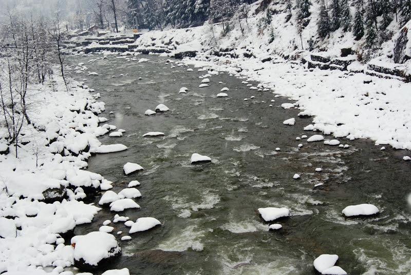 Snow across Beas River in Manali