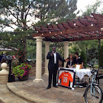 Reggie Rivers auctioning off some Bronco and cycling items.