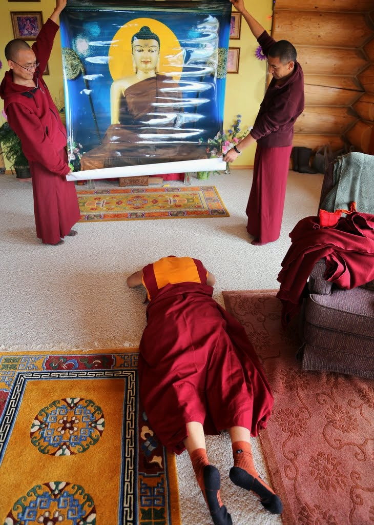 Lama Zopa Rinpoche prostrating to an image of Shakyamuni Buddha, Buddha Amitabha Pure Land, Washington, US, 2014. Photo by Ven. Thubten Kunsang.