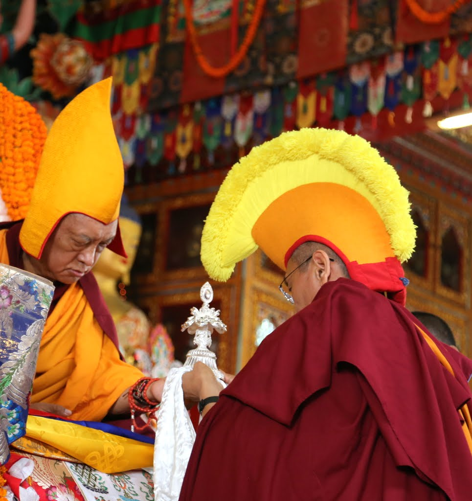 Khen Rinpoche Geshe Chonyi making offerings to Lama Zopa Rinpoche during long life puja, Kopan Monastery, December 12, 2014. Photo by Ven. Thubten Kunsang.