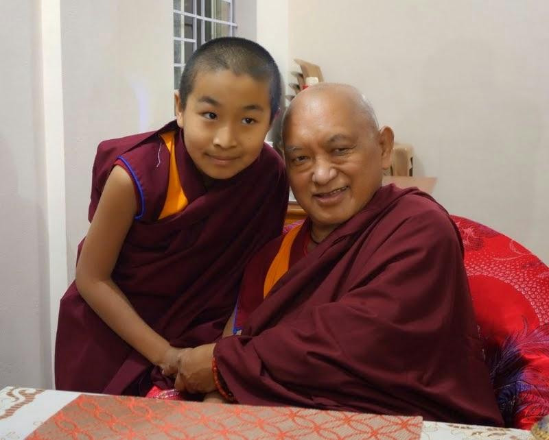 Geshe Domo Rinpoche's tulku with Lama Zopa Rinpoche, Domo Labrang, Sera Monastery, India, January 2014. Photo by Ven. Roger Kunsang.