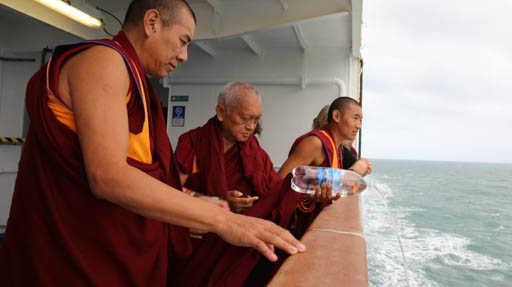 Lama Zopa Rinpoche pouring blessed water into the strait between New Zealand's North and South Islands to benefit all the sentient beings in the ocean, May 2015. Phtot by Ven. Thubten Kunsang.