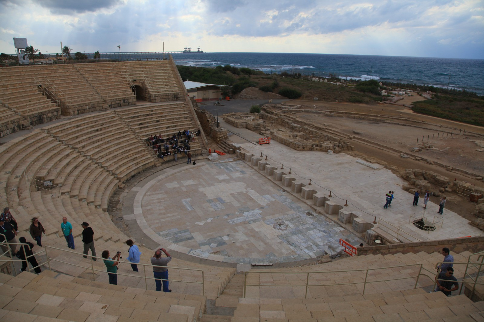 Which Roman city could survive without an amphitheatre?