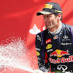 Mark Webber on the podium with Champagne