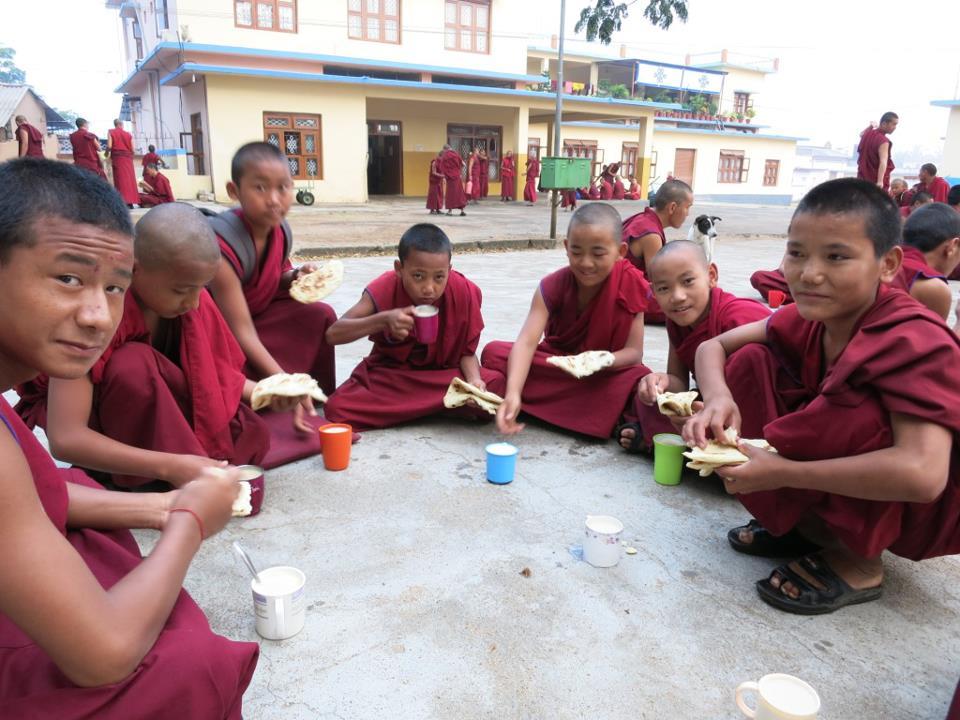 Young monks enjoying breakfast.