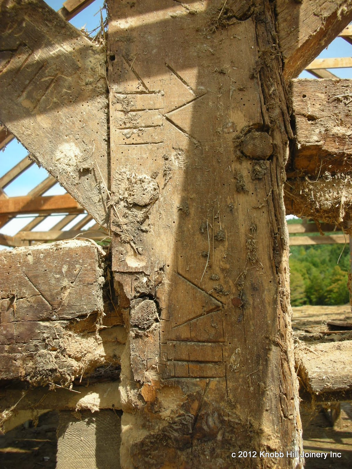 Gouge marks can be seen around the peg holes for setting a nose auger.  The marriage marks throughout the barn were very consistent with the exception of those on this post.  The numerals seen here are redundant to those of the adjacent reference posts.