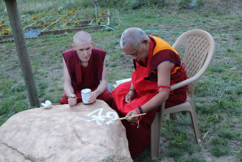 Writing mantras on a rock with Ven.Tharchin