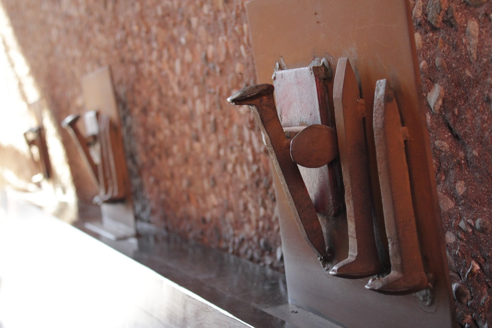 Chapel Of The Holy Cross - Sedona Row numbers in Roman Numerals made from railroad spikes welded together