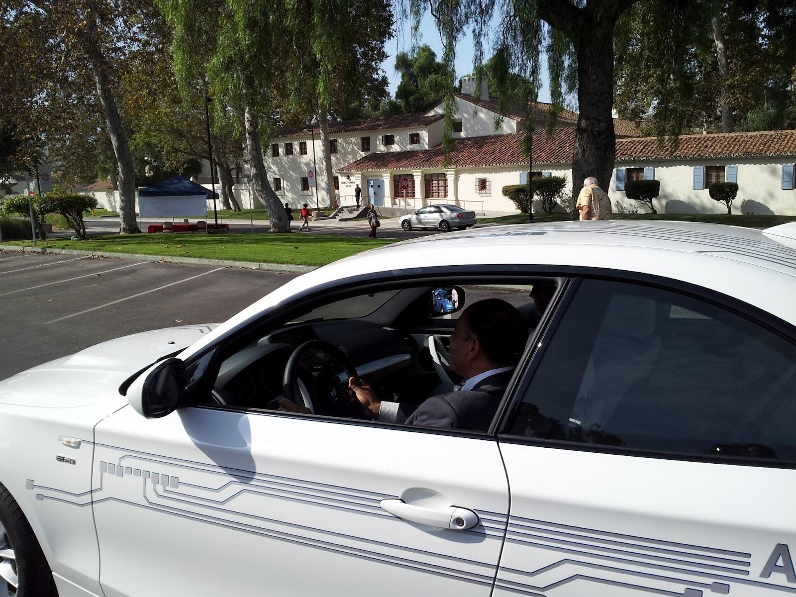 Senator Lou Correa test driving BMW's Active E