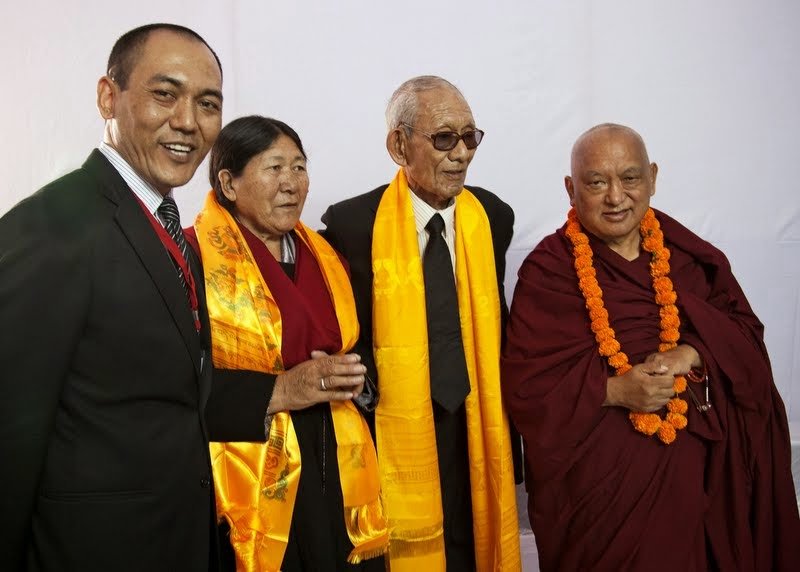 Lama Zopa Rinpoche with honored guest and Kushinagar District Magistrate Rigzin Samphel (far left) before ceremony, Kushinagar, India, December 13, 2013. Photo by Andy Melnic.