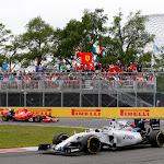 Valtteri Bottas, Williams FW37 Mercedes, leads Kimi Raikkonen, Ferrari SF-15T