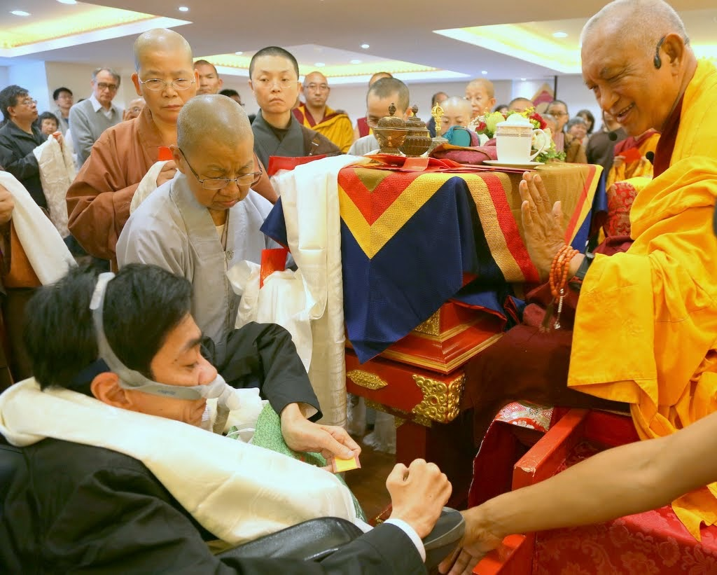 Lama Zopa Rinpoche with students after opening ceremony at Jinsiu Farlin, Taipei, Taiwan, April 2014. Photo by Ven. Thubten Kunsang.