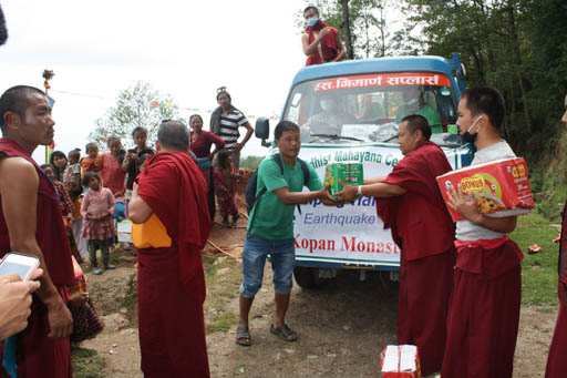 Kopan monks distributing aid to people affected by the eathquake, Nepal, April 2015