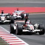 Rubens Barrichello, Honda RA106. Leads team mate Jenson Button, Honda RA106