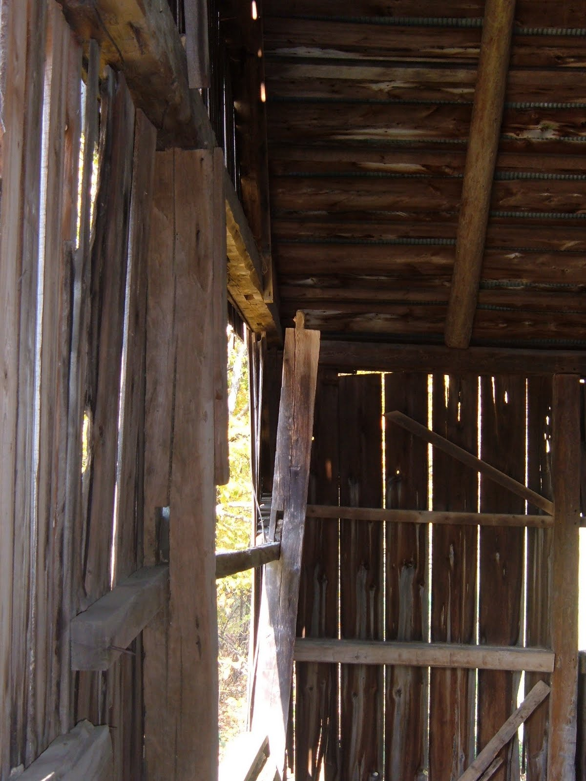 A post on the gable wall is held only by the siding and girts.