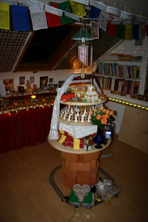 Altar with an animal liberation train taking the worms around holy objects in Switzerland