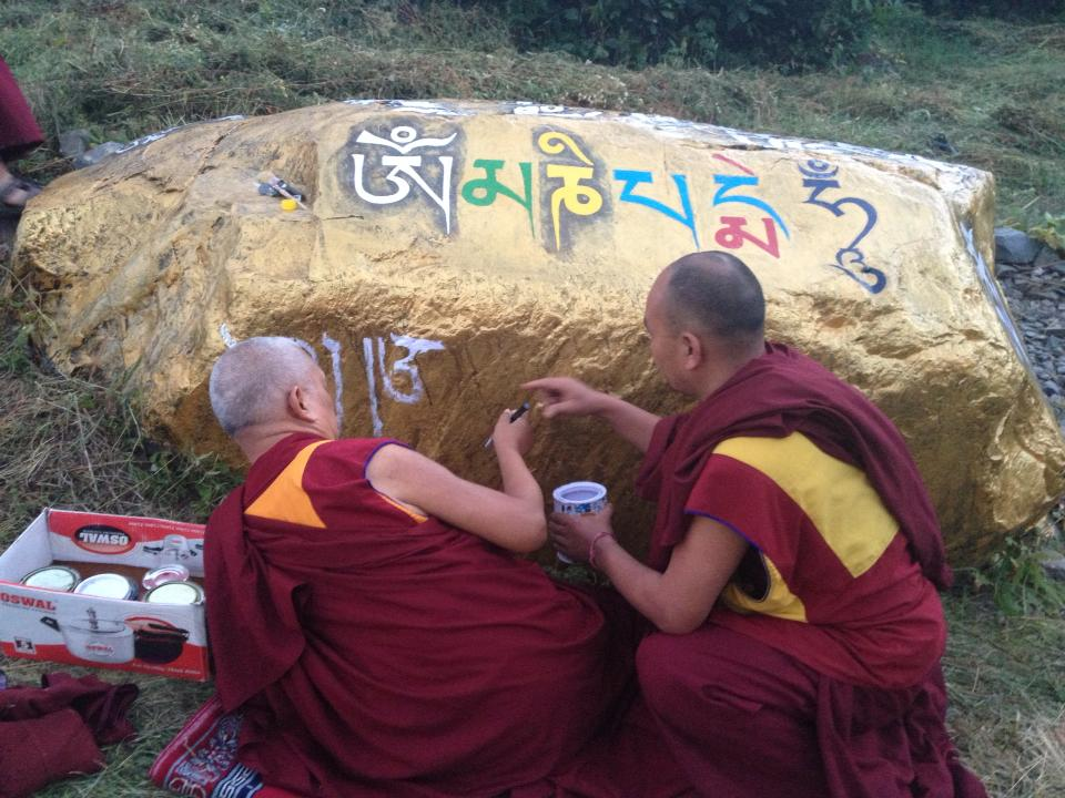 Rinpoche writing mantras on rock, July 2013, Manali, India. Photo. Ven. Sangpo Sherpa