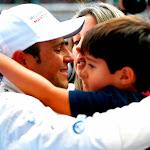 Felipe Massa hugs his family after qualifying on Pole position