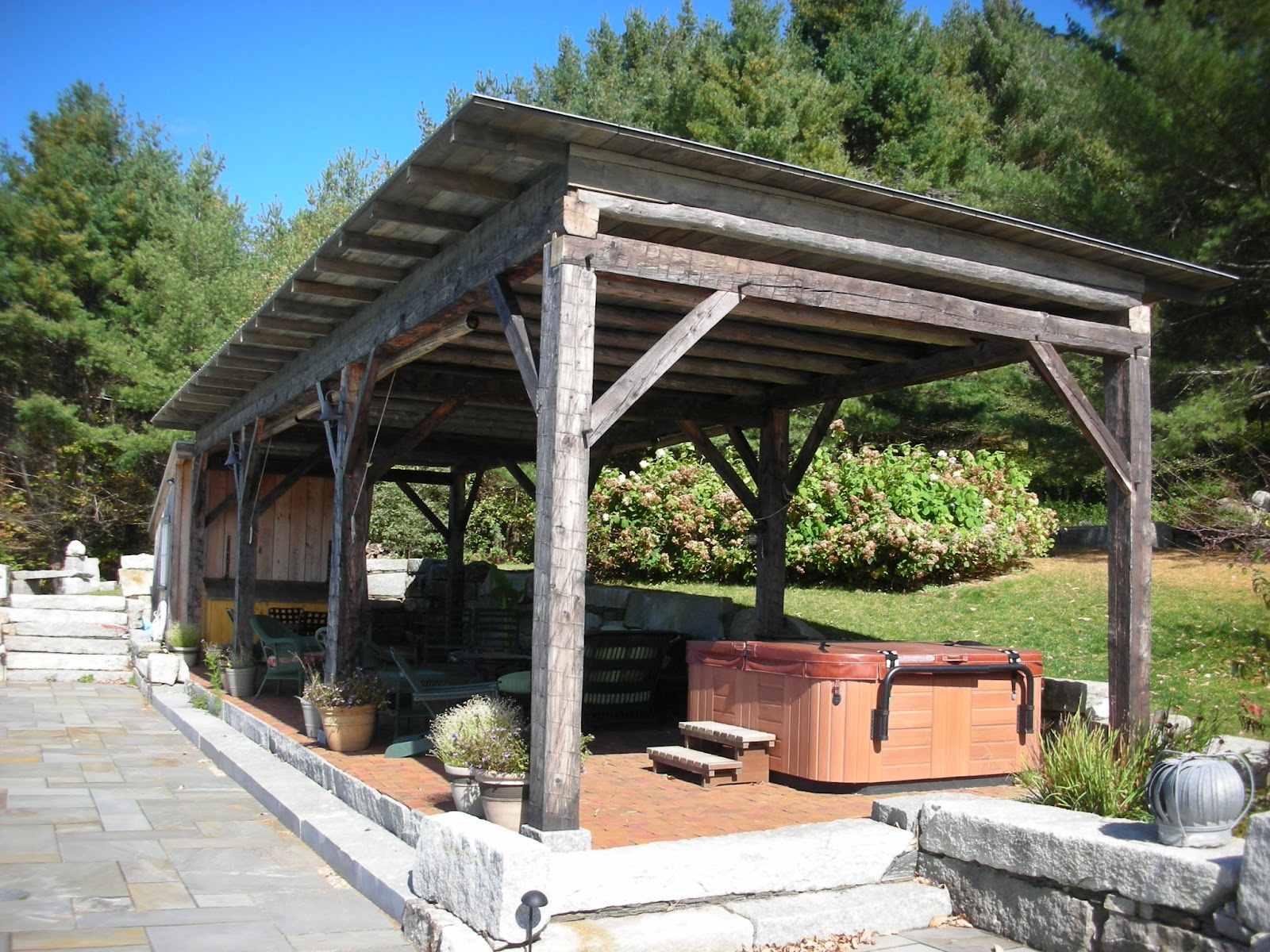 After a few years of exposing the pergola to the elements, the owners had a roof put on to protect the frame.