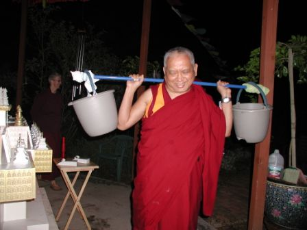 Lama Zopa Rinpoche carrying 400 worms in buckets around a stupa at Kachoe Dechen Ling, in California, USA