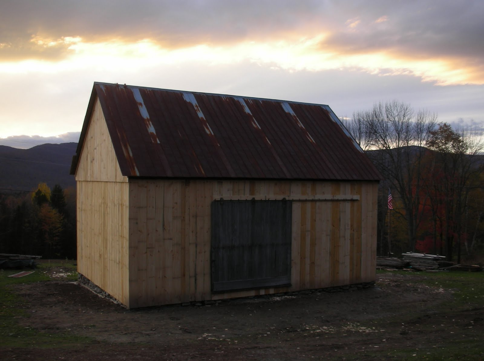 The door was found inside of the barn laying across the middle girts above the stanchion.