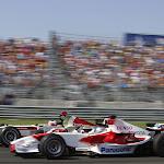 Rubens Barrichello, Honda RA106. Overtakes Jarno Trulli, Toyota TF106