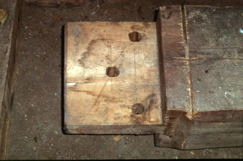 Tie beam end showing drawbore layout marks.