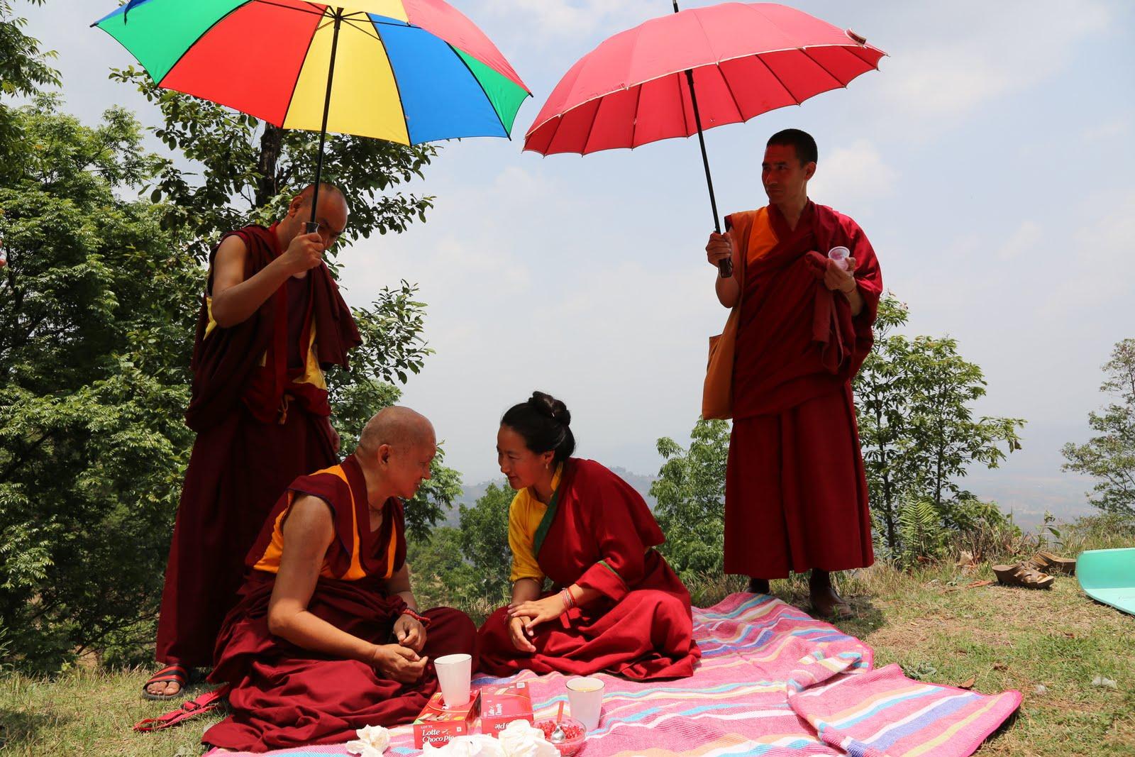 RinpocheandKhadro-lahighaboveKathmandu onpilgrimagetoaholyplaceofGuruRinpoche.Photo byVen. ThubtenKunsangMay7, 2013