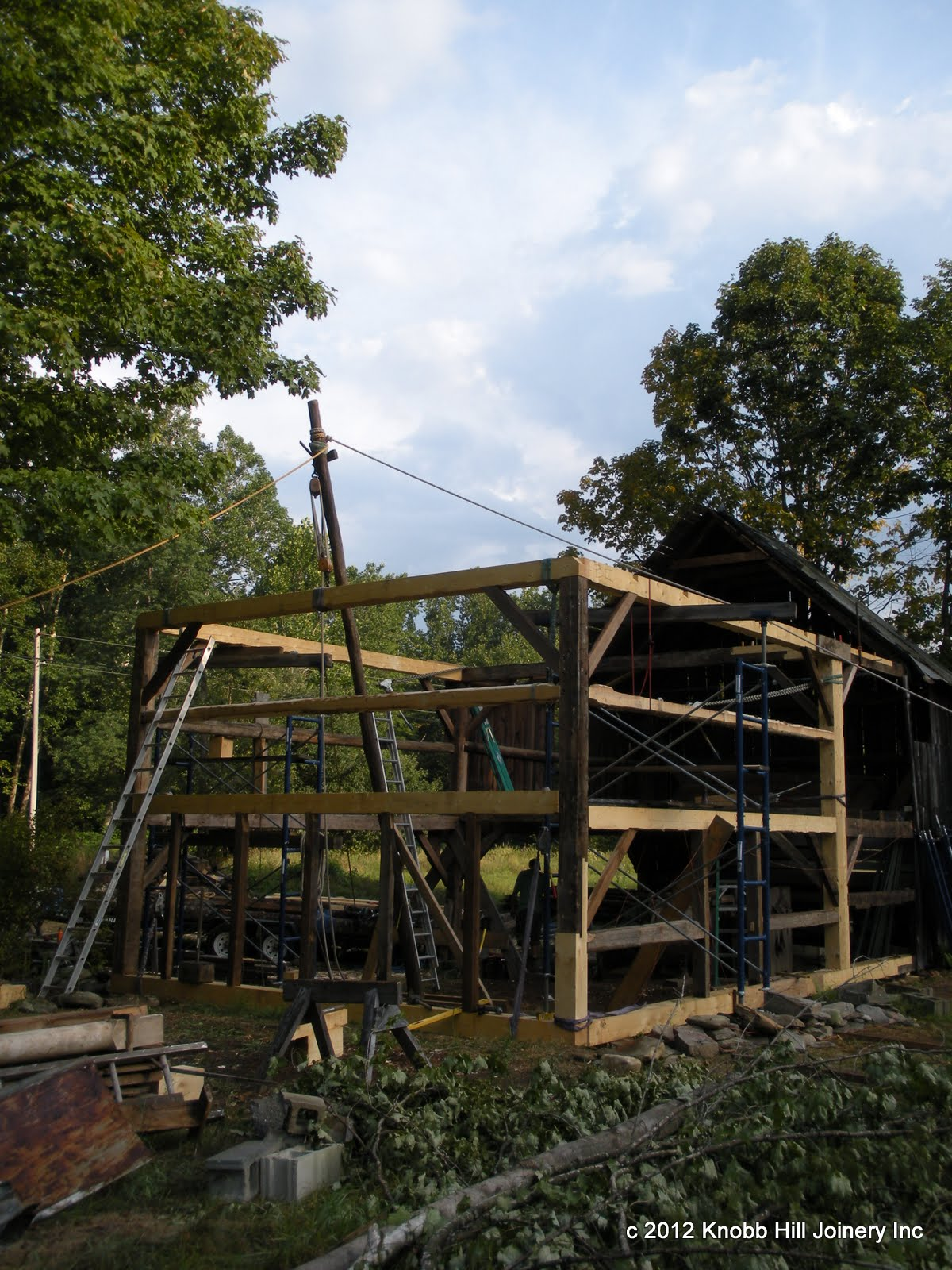 After a long minute of pulling, the new gable wall was lifted into place with the gin pole.