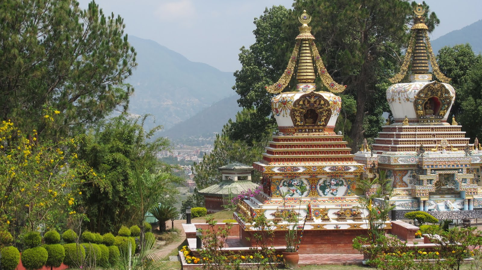 """Two Friends,"" Khensur Lama Lhundrup's stupa next to Geshe Lama Konchog's stupa at Kopan Monastery, Nepal."