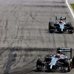 Jenson Button leads Kevin Magnussen