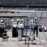 Rubens Barrichello, Honda RA106 approaches as his team wait to perform a pitstop