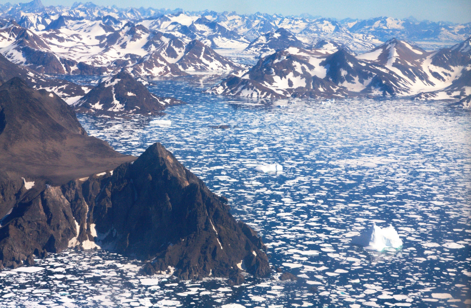 Finally! The east shore of Greenland after a long flight on a Fokker with propellers over the Arctic Ocean!