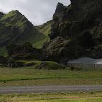 Farm buildings hidden in the rocks