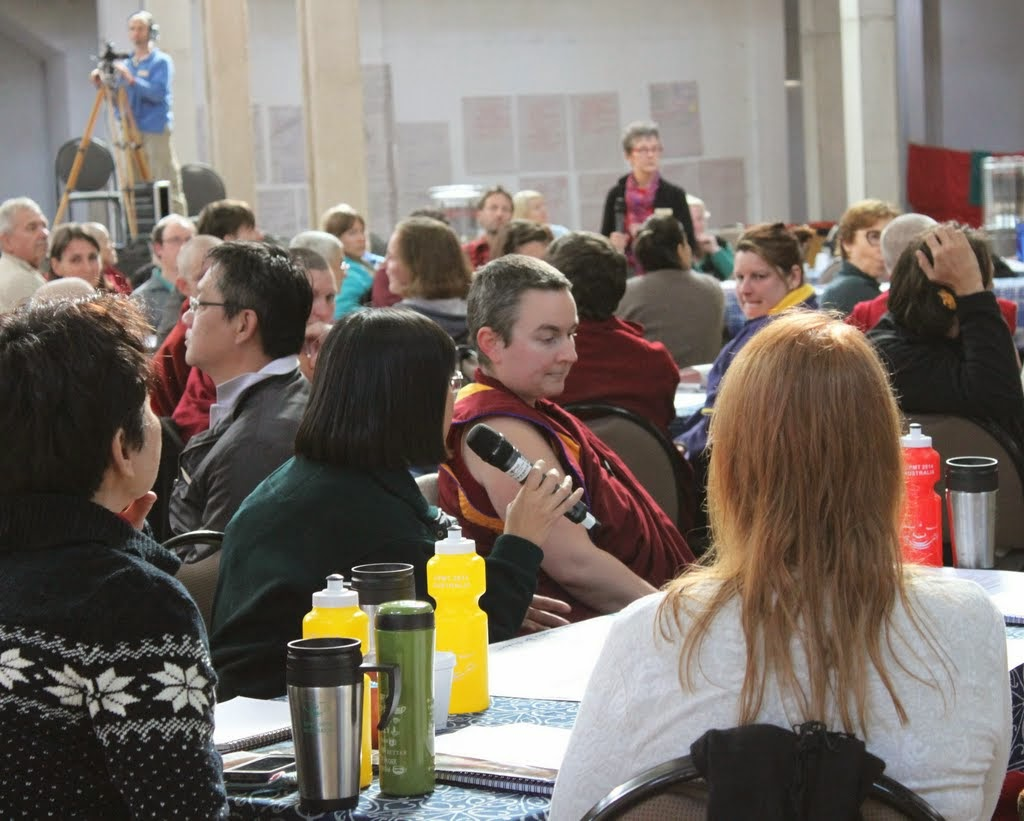 Reporting back after small group discussion on FPMT education programs, CPMT 2014, Australia, September 2014. Photo by Laura Miller.