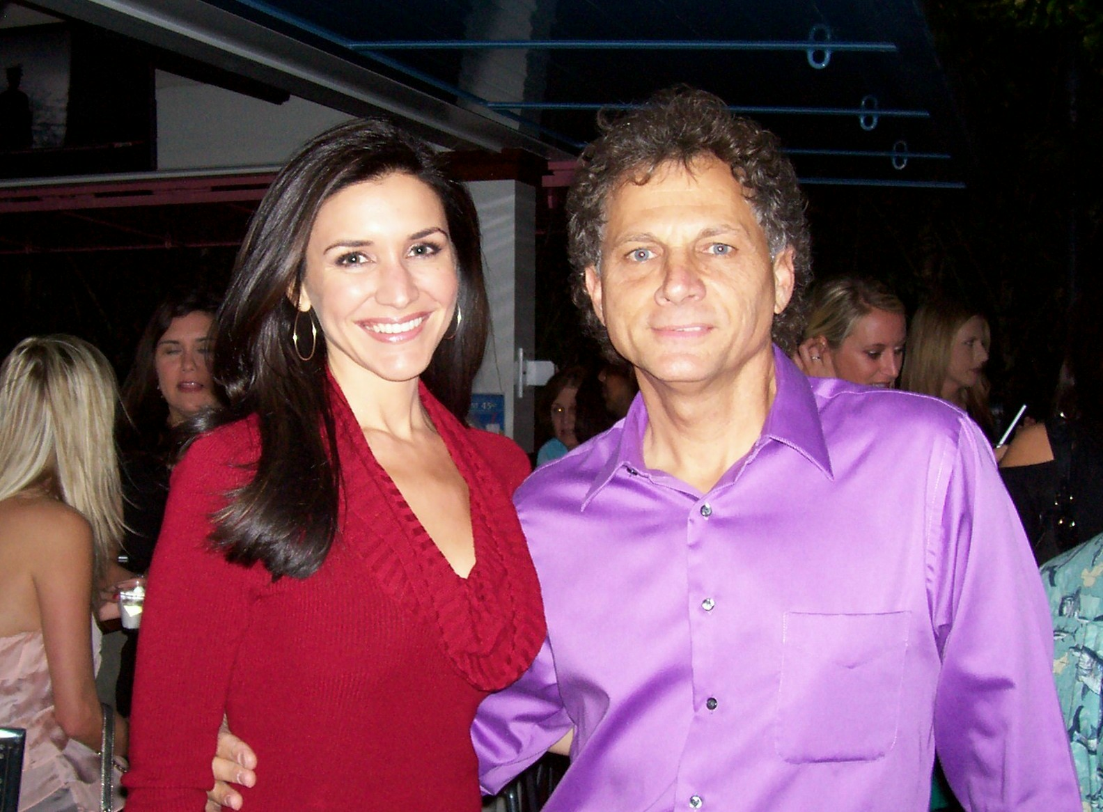 "Jimmy at the ""Adopt–a–Family 4 the Holidays"" fundraiser with meteorologist Lissette Gonzalez."