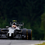 Kevin Magnussen down hill in his McLaren MP4-29