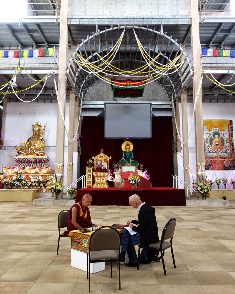 Lama Zopa Rinpoche with Ian Green discussing the decorations for the interior of the Great Stupa of Universal Compassion, Australia, October 2014. Photo by Ven. Roger Kunsang.