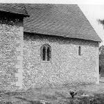 St Mary's Church. The church chancel exterior from the south showing the flint-faced wall and Norman windows. Copyright © Oxfordshire County Council Photographic Archive. Reproduced with the kind permission of Oxfordshire Studies. This photograph may be purchased from their Heritage Search web site at http://www.oxfordshire.gov.uk/heritagesearch