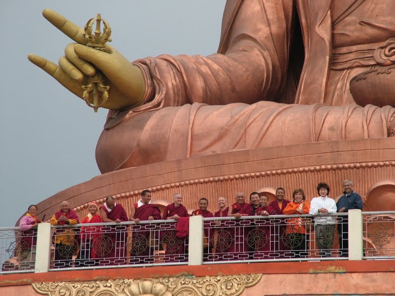 Lama Zopa Rinpoche and students at the large statue of Padmasambhava in Sikkim
