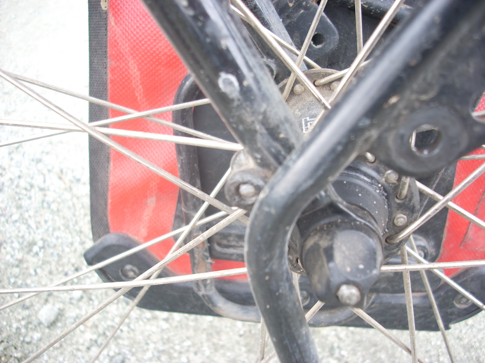 See to the left of the rack, the sheared off bolt?