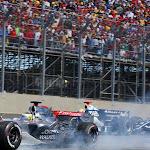 Pedro de la Rosa burns some rubber in the first corner of the 2006 Brazilian F1 GP