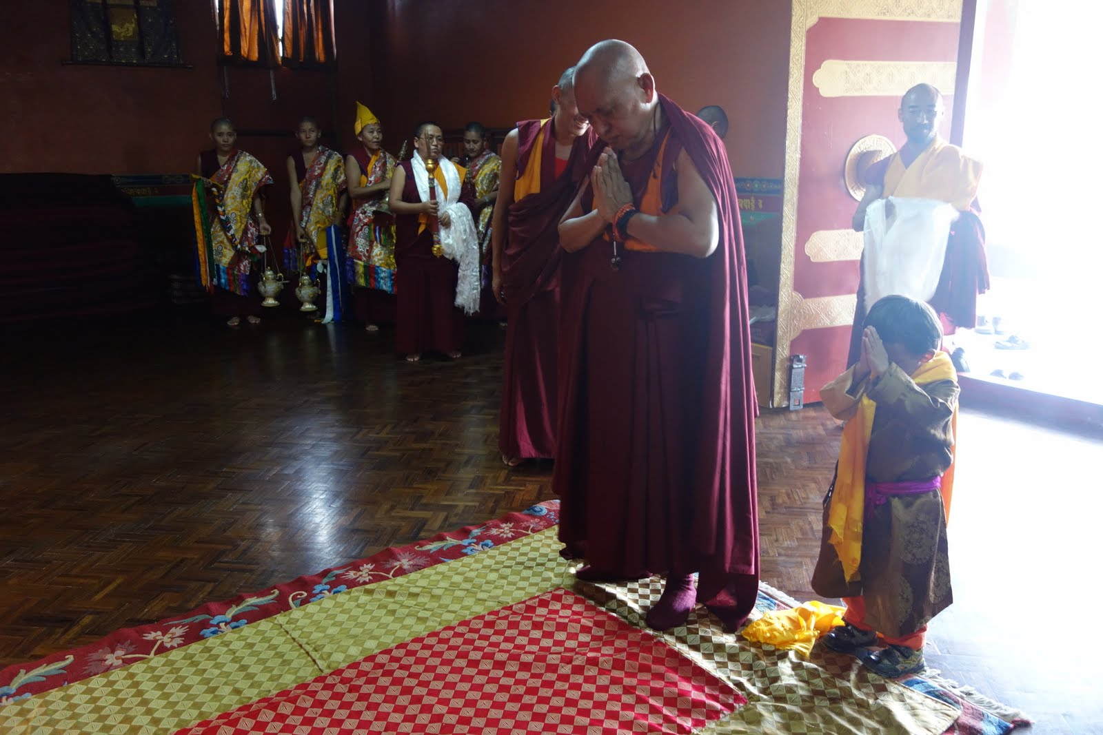 Rinpoche entering the Kopan Nunnery gompa. The very small young lama at his side wanted to copy everything Rinpoche did! August 3, 2013 Photo: Ven. Roger Kunsang