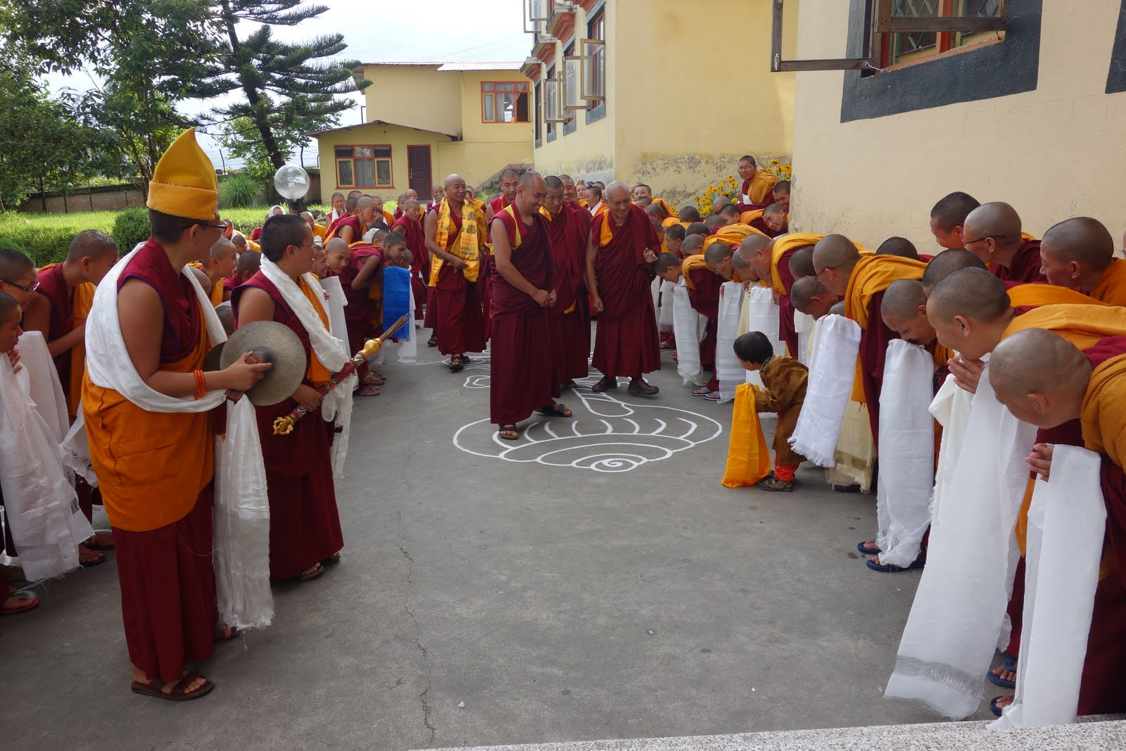 The Kopan Nuns and one very young lama, six years old, greeting Rinpoche on his arrival at Kopan. August 8, 2013 Photo: Ven. Roger Kunsang