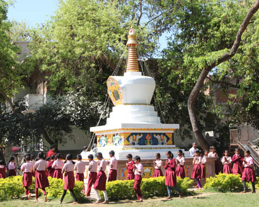 Student circumambulate the stupa during Lama Zopa Rinpoche's visit to Maitreya School, Bodhgaya, India, March 2015. Photo by Ven. Roger Kunsang.